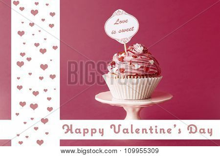 Delicious cupcake with inscription on dark pink background