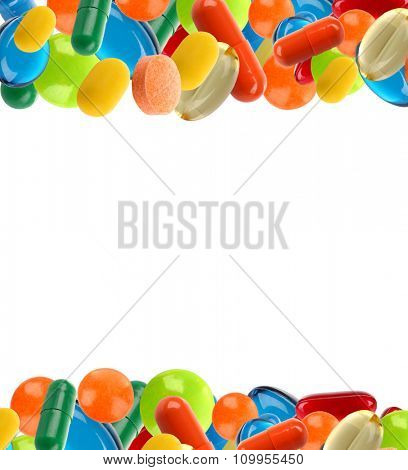 Different pills shaped as frame isolated on white