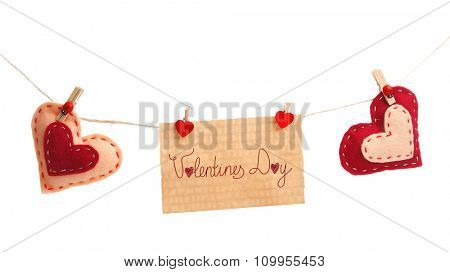 Textile hearts and sheet hang on cord isolated on white