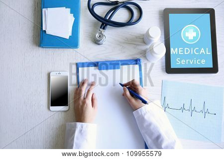 Young woman using his tablet-pc, concept of medical service