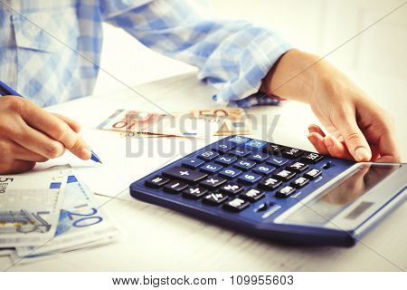Accounting concept.Analyzing finance report with calculator