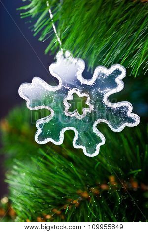 branch of Christmas tree with snowflake