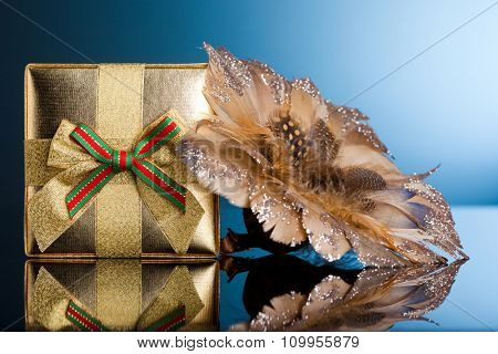 golden gift box with poinsettia