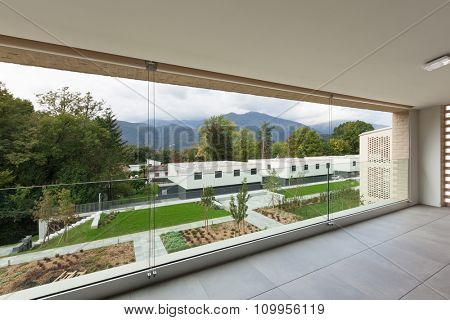 Architecture, new apartment, wide balcony with garden view