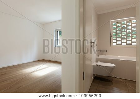 interior of new apartment, empty room with bathroom, parquet floor
