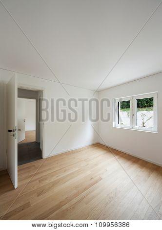 interior of new apartment, empty room with window, parquet floor
