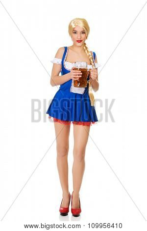 Young and beautiful bavarian woman with beer.