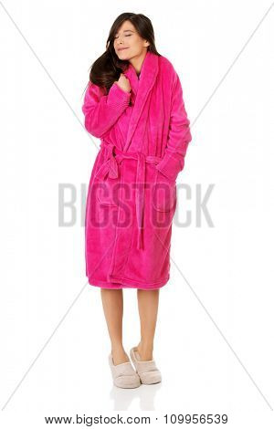 Beautiful caucasian woman wearing pink bathrobe.