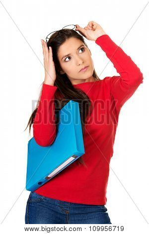 Young student woman holding blue folder.