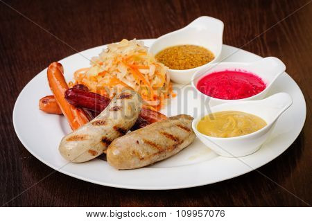 german traditional beer snack, sausage with sauces cabbage