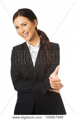 Businesswoman with thumb up gesture.