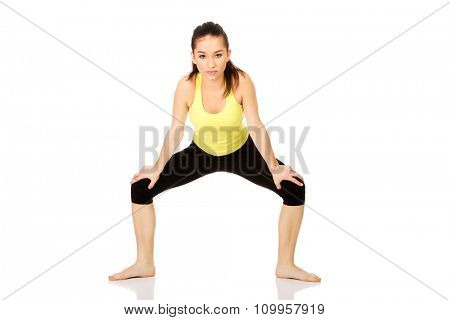 Young fitness woman in warm up exercise.