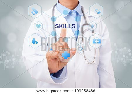 Doctor hand touching SKILLS sign on virtual screen. medical concept