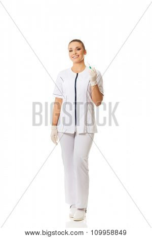 Dentist doctor holding a syringe