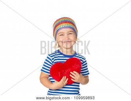 Little Girl Holding A Red Heart Toy.