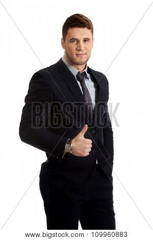 Happy handsome smiling businessman with thumbs up gesture.