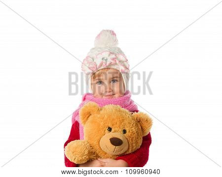 Little Girl In Warm Hat And A Red Sweater With Teddy Bear On A White Background.