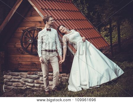 A young bride and groom standing together outdoor, summer time