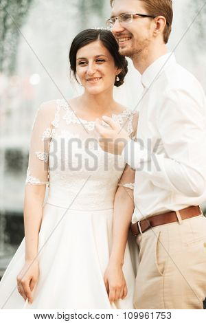 caucasian happy romantic young couple celebrating their marriage