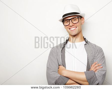 relaxed young casual man with hat