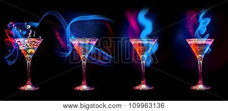 Colorful Bright fresh modern cocktails in glasses on black background with reflection