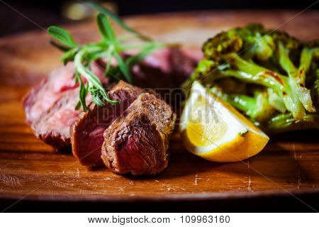 Delicious appetizer with herbs on wooden table close up