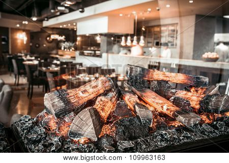Interior of modern restaurant with fireplace close-up