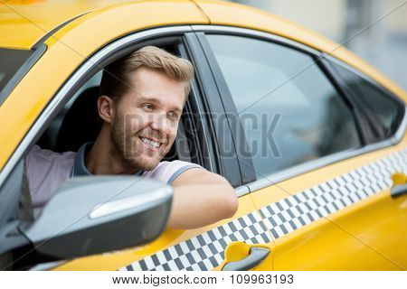 Young driver in a taxi