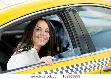 Beautiful young girl in a taxi