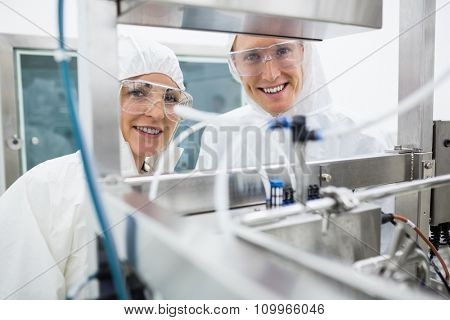 Scientists working with large vat in the lab