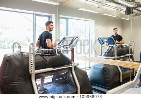 Athlete working out on an anti gravity treadmill at the gym