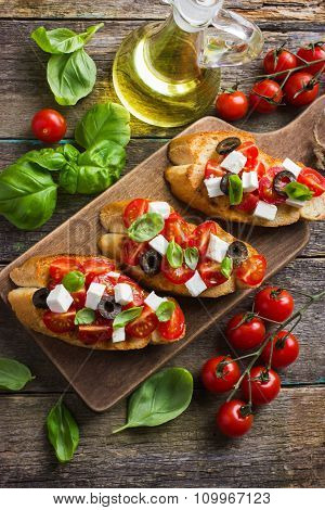Bruschetta With Tomato, Feta Cheese And Basil