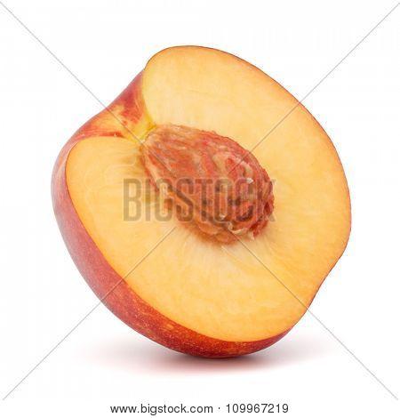 Nectarine fruit half isolated on white background close up