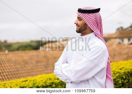 handsome Arabian man looking away