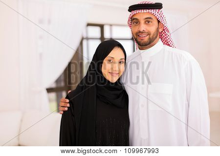 close up portrait of happy muslim couple at home