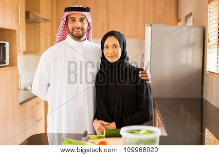 happy muslim couple in kitchen
