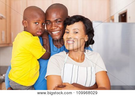 portrait of african young african family standing in the kitchen together