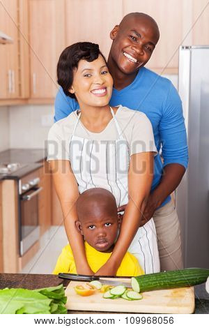 beautiful young african american family in home kitchen
