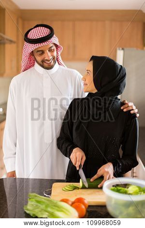 lovely arabian couple cooking in home kitchen