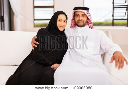 beautiful middle eastern couple relaxing on the couch