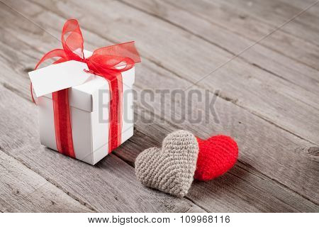 Valentines day gift box and hearts on wooden table with copy space