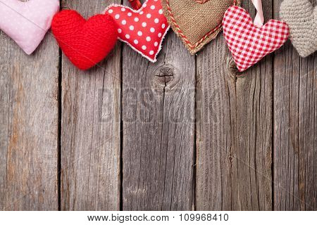 Handmaded Valentines day hearts on wooden table. Top view with copy space