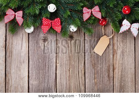 Christmas tree with decor on wooden table with copy space