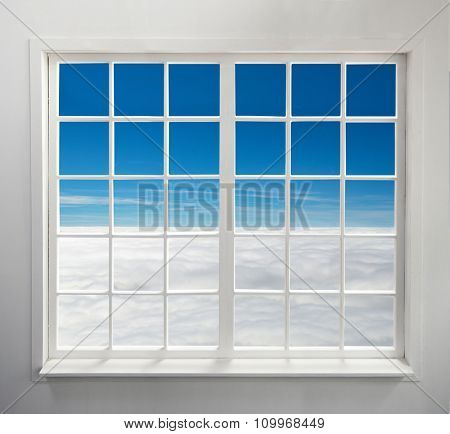 Modern residential window with heavenly view above clouds