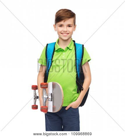 childhood, leisure, school and people concept - happy smiling stdent boy with backpack and skateboard