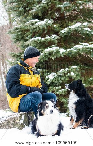 Man With Dogs In Winter