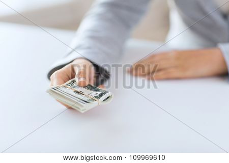 business, finance, saving, banking and people concept - close up of woman hands holding us dollar money