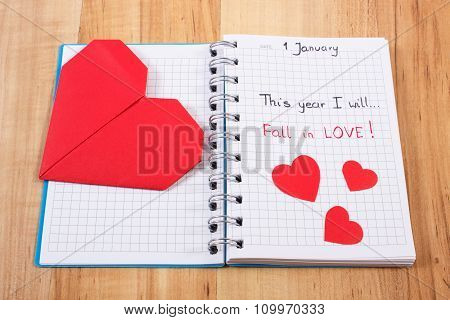New Years Resolutions Written In Notebook And Red Paper Hearts