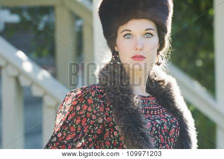 Head And Shoulders Portrait Of Russian Beautiful Woman Wearing Fur Cossack Hat And Fur Collar