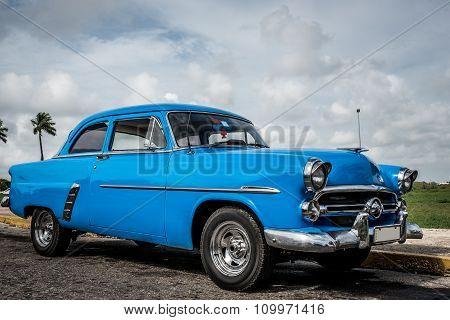 HAVANA, CUBA - JUNE 19, 2015: Blue american classic car parked in a parking lot in Havana Cuba